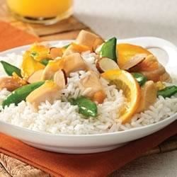 Yummy Orange Chicken and Rice Recipe - Grilled or roasted chicken simmered in orange marmalade with delicious orange slices and crispy sugar snap peas served over Minute White or Brown rice.