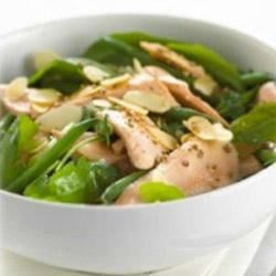Hot Salmon Salad with Maille(R) Honey Dijon Mustard Recipe - This simple arugula salad is tossed with a honey Dijon vinaigrette and poached salmon, green beans, and almonds. An elegant meal for lunch or dinner.