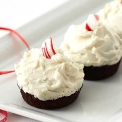 Frosted Peppermint Mini Bites Recipe - Minty mini chocolate cupcakes are frosted with buttery vanilla frosting and sprinkled with crushed peppermint for a festive dessert.