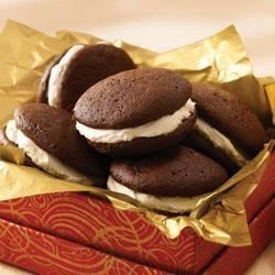 Triple Chocolate Whoopie Pies Recipe - Smooth marshmallow creme filling is sandwiched between 2 devil's food cake rounds.