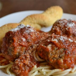 Italian Meatballs Recipe - Baked meatballs seasoned with oregano and garlic, simmered in spaghetti sauce.