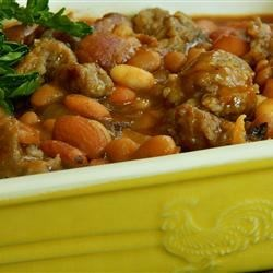 Aunt Ro's Baked Beans Recipe - Easy to make using a variety of canned beans, this recipe combines butter beans, pinto beans, pork and beans, and chopped onion with traditional seasonings for rich, savory baked beans.