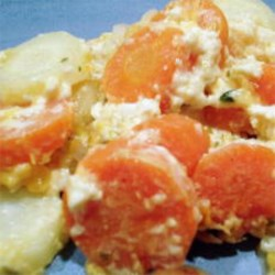 Carrot Casserole with Cheese Recipe - Carrots made creamy with processed cheese and heavy cream, and baked with a bread crumb crust.