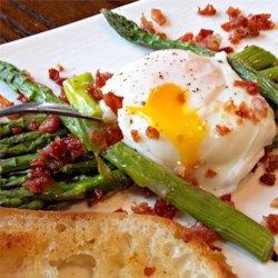Roasted Asparagus Prosciutto and Egg Recipe - Prosciutto and asparagus pair deliciously with poached eggs and a sprinkling of lemon.