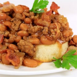 Cowboy Casserole Recipe - This combination of hamburger, beans, and bacon over biscuits will bring out the cowboy in anyone.  It has become a family favorite.  It is so easy to make, and we love to make it when we're camping.