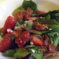 Strawberry Spinach Salad With Feta and Bacon Recipe - Strawberry spinach salad has feta cheese, sweet onion, and crumbled bacon all tossed with a raspberry vinaigrette dressing.
