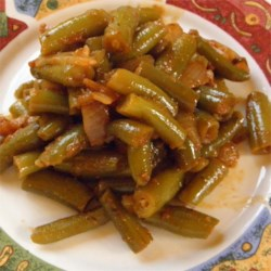 Green Beans in Seasoned Tomato Sauce Recipe - Green beans are simmered in cinnamon-spiced tomatoes creating a side dish reminiscent of the Lebanese recipe 'Loubieh Bel Zeit.'