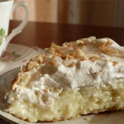 Old Fashioned Coconut Cream Pie Recipe and Video - Sweetened toasted coconut is stirred into a homemade custard filling and poured into a pie shell. After the pie is chilled and set, it's covered with whipped topping and more toasted coconut.