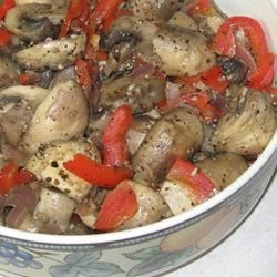 Marinated Mushrooms with Red Bell Peppers Recipe - This recipe calls for fresh mushrooms and red bell pepper to be boiled in a mixture with red wine vinegar, parsley, basil, garlic, and onion.