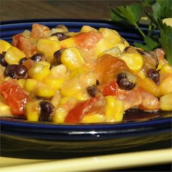 Mexican Corn Casserole  Recipe - Corn, tomatoes, and black beans are baked with cream cheese and Cheddar cheese for a creamy, quick, and easy side dish.
