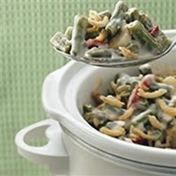 Slow Cooker Green Bean Casserole Recipe - Throw all the traditional ingredients for green bean casserole in the slow cooker on Thanksgiving morning, and it will be ready by the time dinner is on the table.
