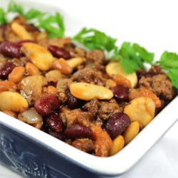 Calico Bean Casserole Recipe - Kidney beans, baked beans and butter beans are combined with ground beef, bacon and onion in this hearty dish. You can also put the ingredients into a slow cooker and cook for about 8 hours on low.