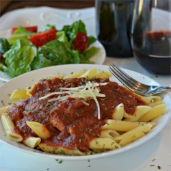Italian Pasta Sauce Recipe - This Italian recipe uses canned tomato sauce, diced tomatoes, tomato paste, and Merlot red wine to deliver a large pot of red pasta sauce everyone will love.