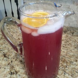 Nonalco Punch Recipe - Cranberry and pineapple juices are sweetened with sugar, flavored with almond extract, and mixed with ginger ale in this festive punch.