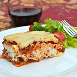 Classic and Simple Meat Lasagna Recipe - A family-pleasing version of lasagna is made with lean ground beef, whole wheat lasagna noodles, prepared sauce, and plenty of mozzarella for a dish that's easy yet hearty.