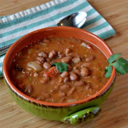 Evana's Pinto Beans Recipe - This recipe for a big pot of pinto beans seasoned with tomato, garlic, and lots of cilantro comes from deep in the heart of Texas.