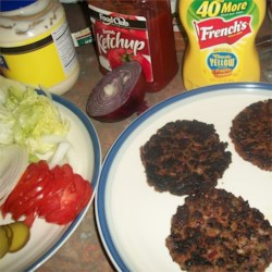 Vegan Bean Burgers Recipe - Adzuki beans and cooked oats are combined with sauteed vegetables creating a versatile and vegan bean burger.