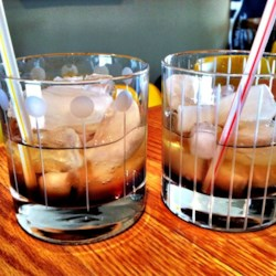 Mind Eraser Recipe - This layered cocktail is made with coffee-flavored liqueur, lemon-lime soda, and vodka.