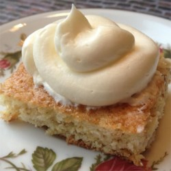 Liz's Banana Bars Recipe - These sweet and moist banana bars are frosted with a cream cheese frosting for a treat sure to become one of your favorites.