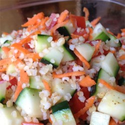 Colorful Bulgur Salad Recipe - The bulgur is cooked in chicken broth which gives it a hearty flavor. And the dressing is pungent and wonderful. All the veggies  - tomatoes, carrots and cucumbers  - blend in beautifully, and the whole salad comes alive when chilled.