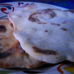 Lefse II Recipe - This version of the traditional Scandinavian tortilla omits the potato entirely and depends on sour milk and a pinch of cardamom for flavor.  Serve with cheese or jam.