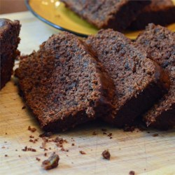 Chocolate Banana Bread Recipe - This banana bread features cocoa, chocolate chips, sour cream and a bit of vanilla extract.