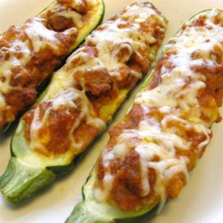 Easy Stuffed Zucchini Recipe - Stuff that big zucchini full of ground beef, cheese, sauce, and olives for an easy baked dinner.