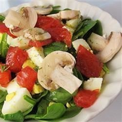 Fabulous Spinach Salad Recipe - Simple dressing of rice wine and olive oil. Simple salad of fresh spinach, tomatoes, mushrooms and hard-cooked eggs. Simply fabulous. Serves four.