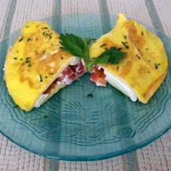 Cream Cheese and Tomato Omelet with Chives Recipe - Impress your family members with a fluffy omelet filled with cream cheese, tomato, and chives for your fancy weekend brunch.