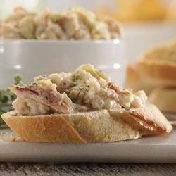 Buttery Crab and Artichoke Dip Recipe - Buttery Crab and Artichoke Dip is a great, gourmet-style appetizer that is sure to turn heads at your gathering. This recipe melds our Roasted Garlic and Parmesan Baby Reds(R) potatoes with crab, artichoke and a variety of cheeses.
