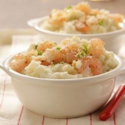 Shrimpy Mashed Potatoes Recipe - Shrimpy Mashed Potatoes is a delicious side dish for any gourmet chef looking to try a new recipe. This family favorite recipe melds our Roasted Garlic Flavored Mashed potatoes, sautéed shrimp and a myriad of flavor to appease and impress everyone.
