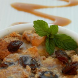 English Bread Pudding Recipe - A spicy bread-like cake containing lots of mixed dried fruit. Best served warmed with a vanilla custard.