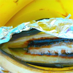 Banana Royale  Recipe - It's easy to make this fun campfire dessert by stuffing a slice of candy bar into a banana, then wrapping the fruit in foil and cooking in the coals of a campfire for a few minutes. They make a nice option to S'mores. Just unwrap and eat with spoons.