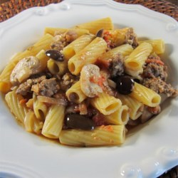 Chef John's Chicken Riggies Recipe and Video - This regional dish from Central New York is a rich pasta sauce made with Italian sausage, chopped chicken, peppers, olives, tomatoes, and cream.