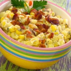 Slow Cooker Creamed Corn with Onion and Chives Recipe - Corn is simmered in a creamy bacon sauce in the the slow cooker for a make-ahead side dish perfect for weeknights.