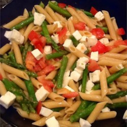 Lemon, Garlic, and Asparagus Warm Caprese Pasta Salad Recipe - When fresh asparagus starts showing up in the stores and farmers' markets, you know it's time to make a fresh pasta dish inspired by the classic Italian salad of tomatoes and fresh basil. Add an optional sliced chicken breast to turn the warm salad into a perfect light lunch.