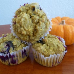 Blueberry Pumpkin Muffins Recipe - Blueberries and pumpkin pair in these nutmeg and cinnamon accented muffins that blend summer and autumn flavors with the tasty texture of quick oatmeal.