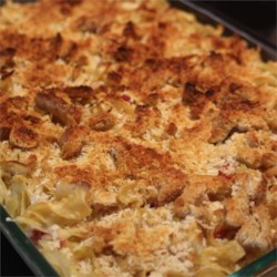 Reuben Mac and Cheese Recipe - Corned beef, Swiss cheese, and sauerkraut add their flavors to a hearty noodle casserole with all the flavors of a Reuben sandwich. There's even golden brown rye bread crumbs on top.