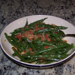 Green Beans in Cider Recipe - Green beans are simmered in apple cider and topped with bacon bits and onions for a lighter green bean side dish for Thanksgiving dinner.