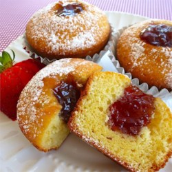 Jelly Doughnut Cupcakes Recipe - Simple but pretty yellow cupcakes are filled with raspberry jam and sprinkled with confectioners' sugar. They taste and look just like jelly-filled doughnuts.
