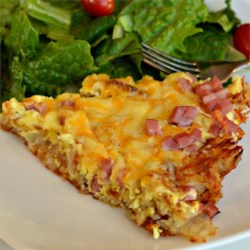 Upside-down Ham and Cheese Quiche Recipe - This upside-down quiche tastes just right, thanks to ham, cream, and plenty of melted cheese.