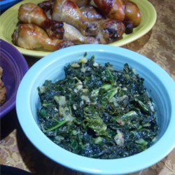 Kale with Kiwi Recipe - Healthy kale gets jazzed up with kiwi, ginger, garlic and lots of black pepper for a lively veggie side dish.