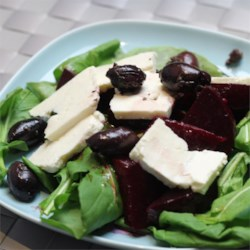 Beet and Arugula Salad Recipe - Sweet, earthy beets make a delightful topping for a salad made with spicy arugula, feta cheese, and Greek olives.