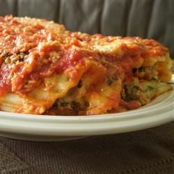 Manicotti Alla Romana Recipe - This rich meat, spinach and cheese filled manicotti dish is covered with white and red sauces.  It takes some time to prepare, but is well worth the effort!