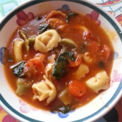Italian Sausage Soup with Tortellini Recipe - Italian sausage, garlic, tomatoes, red wine, and tortellini - this soup combines favorite ingredients from an Italian kitchen.  You can use sweet or hot sausage, depending on your tastes, and fresh herbs if you have them on hand.