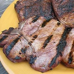 Wine Infused Grilled Pork Chops Recipe - Center-cut pork chops are so lean that grilling can make them dry. Brining with Holland House cooking wine changes that, infusing the pork with moisture and a rich, red wine flavor.