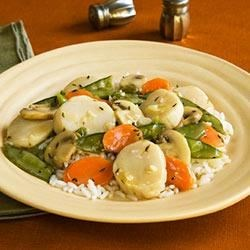 Scallops Primavera Recipe - After marinating 30 minutes, scallops are quickly cooked in a lemon and sherry sauce with carrots, mushrooms, pea pods, and green onions for a fast and fresh seafood dinner.