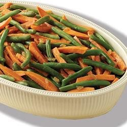 Green Bean and Sweet Potato Medley Recipe - Roasted sweet potatoes are tossed with green beans and a sweet sherry sauce.