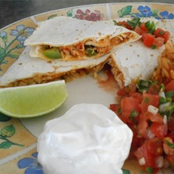 Pico de Gallo Chicken Quesadillas Recipe - A fresh tomato-onion relish combines with jack cheese and a saute of chicken, onion and green pepper to fill these grilled tortilla sandwiches.