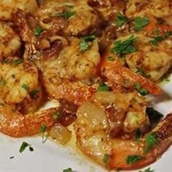 Val's Spicy Baked Shrimp Recipe - Yummy shrimp are baked in a spicy, buttery, bacon sauce with a hint of Dijon mustard. Serve this as an appetizer or over pasta for an elegant meal.
